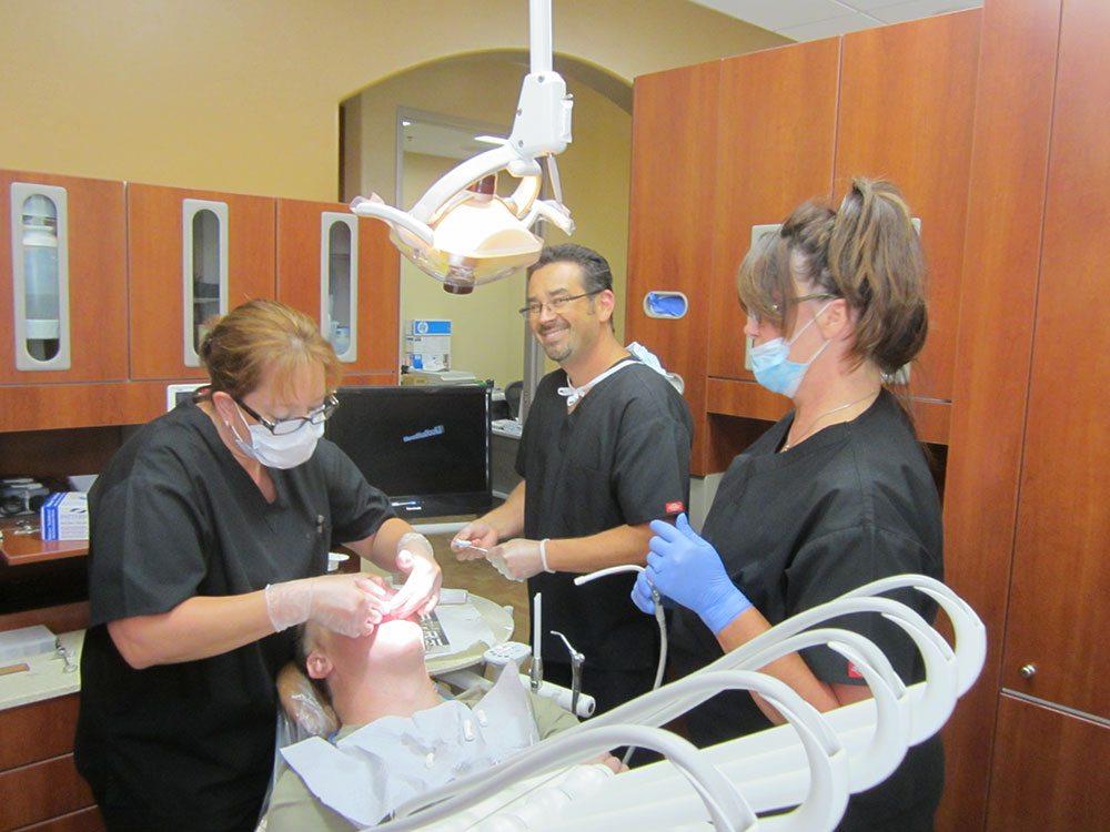 Dr. Derek B. Hauser, DDS, and his Registered Dental Assistants