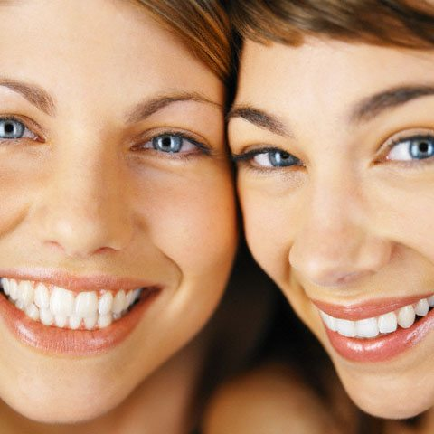 Women smiling --- Image by © Bernd Vogel/Veer/Corbis